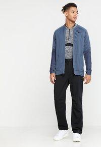 Nike Golf - HYPERSHIELD PANT CORE - Pantalon classique - black - 1