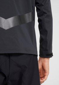 Nike Golf - Vodotěsná bunda - off noir/black/photo blue - 6