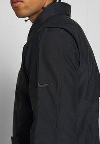 Nike Golf - REPEL PLAYER - Waterproof jacket - black - 4