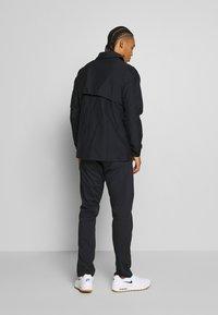 Nike Golf - REPEL PLAYER - Waterproof jacket - black - 2