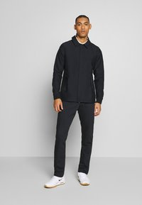 Nike Golf - REPEL PLAYER - Waterproof jacket - black - 1