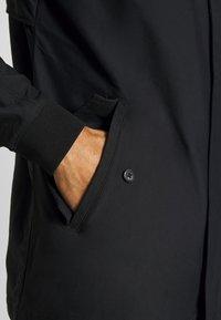 Nike Golf - REPEL PLAYER - Waterproof jacket - black - 6