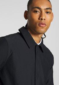 Nike Golf - REPEL PLAYER - Waterproof jacket - black - 3