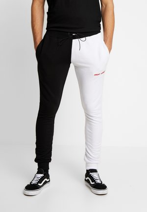 FERN - Tracksuit bottoms - black/ white