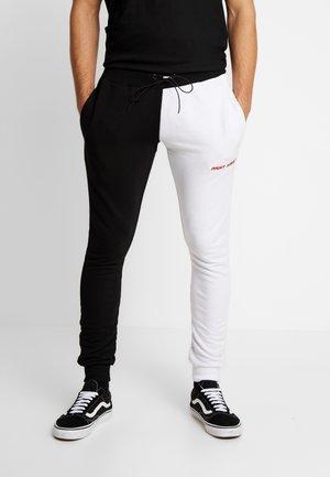 FERN - Pantalon de survêtement - black/ white