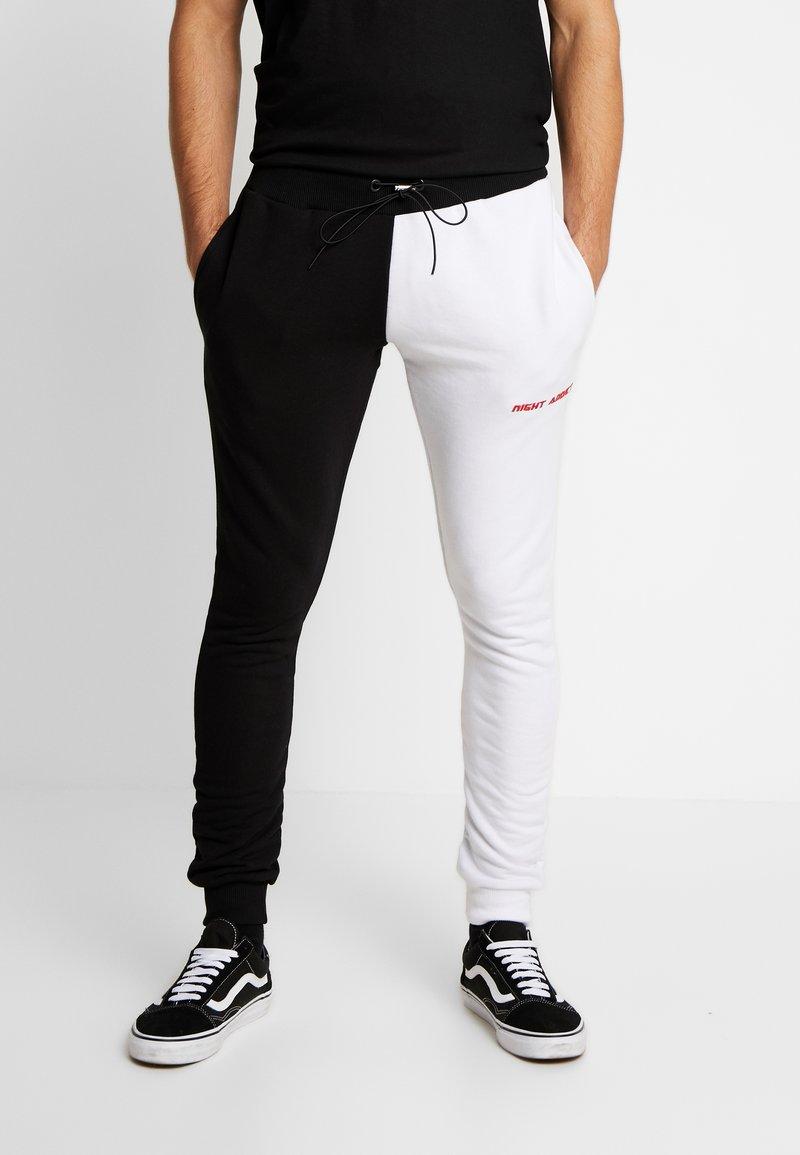 Night Addict - FERN - Pantalon de survêtement - black/ white