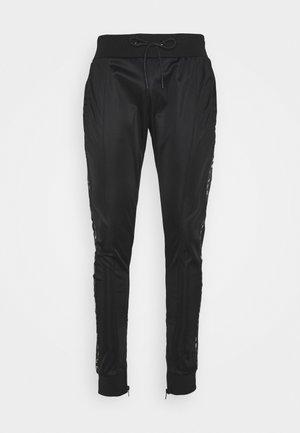 VIPER - Tracksuit bottoms - black