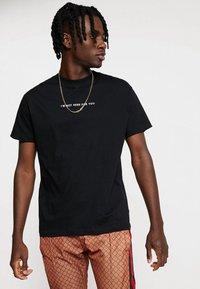 Night Addict - Print T-shirt - black - 0