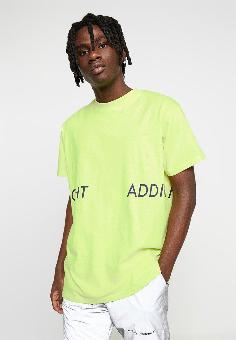 Night Addict - MILES - T-Shirt print - neon pastel yellow