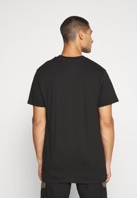 Night Addict - Print T-shirt - black - 2
