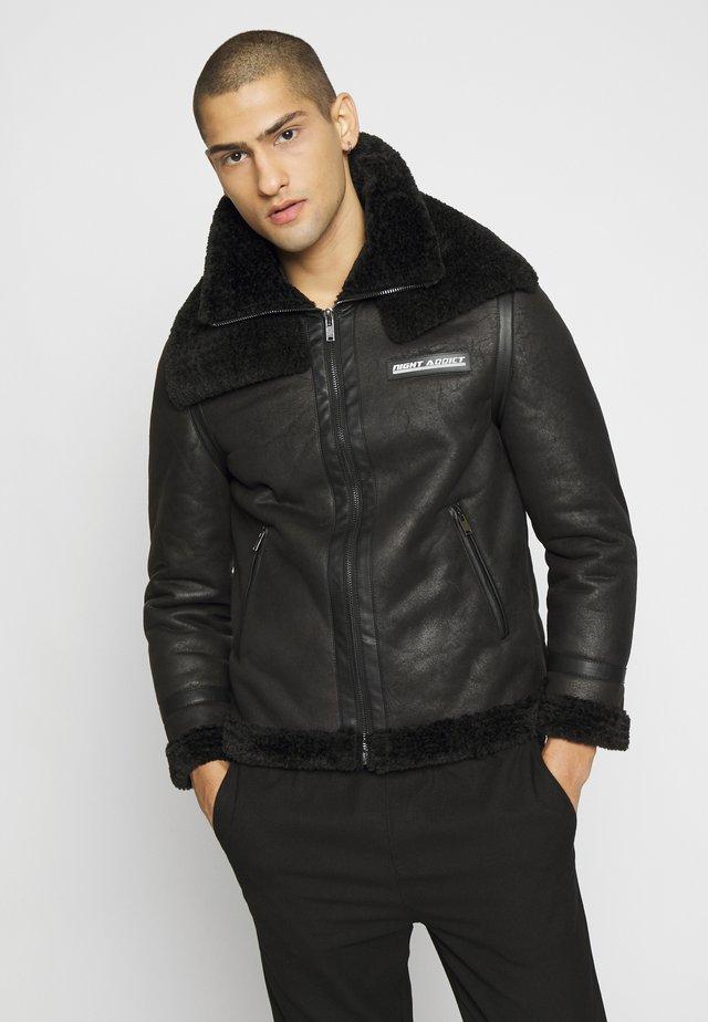 NANIMAI - Faux leather jacket - black