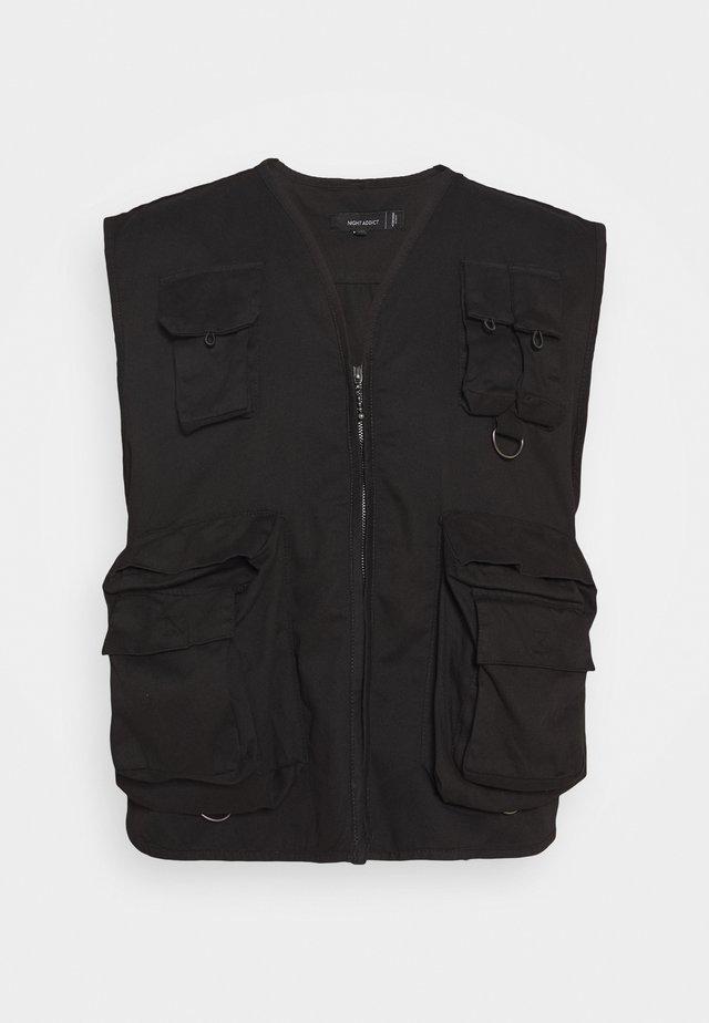 NADUKE - Waistcoat - black