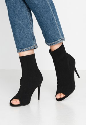 STRETCH - High heeled ankle boots - black