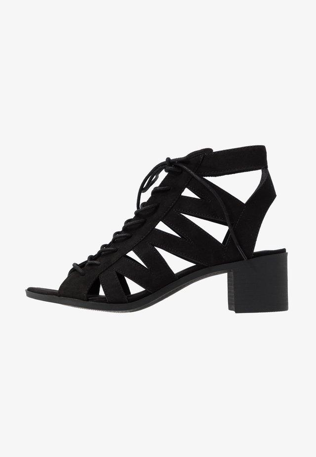 PELICAN - Sandalen met enkelbandjes - black