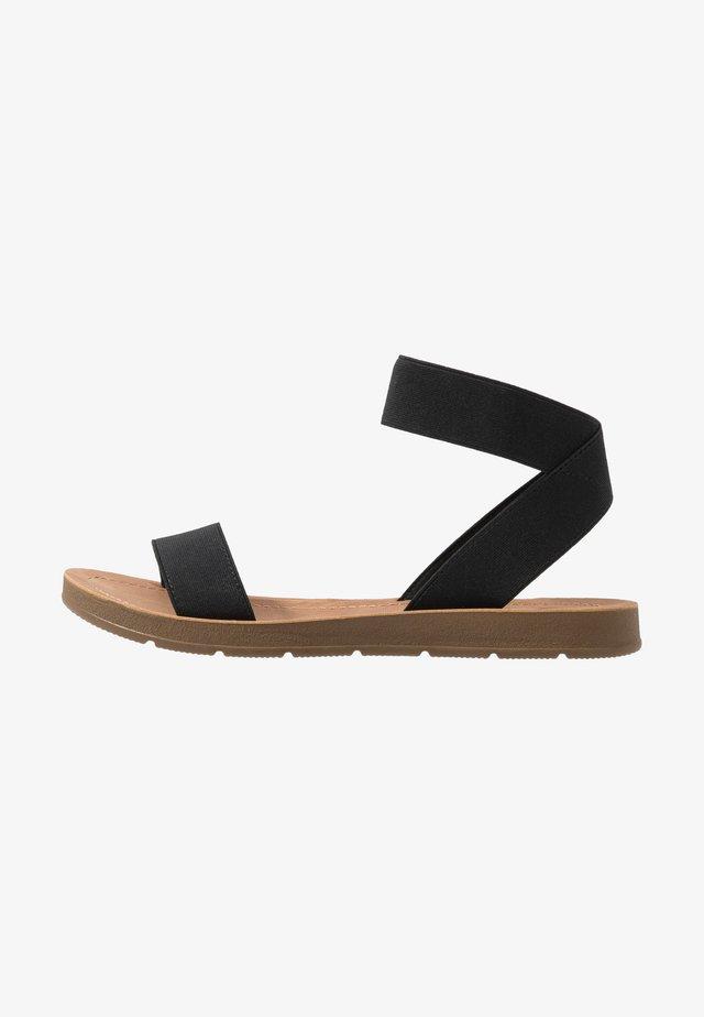 IZZY - Sandals - black