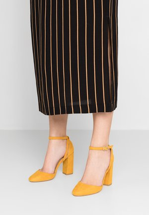 STEEP - High heels - dark yellow