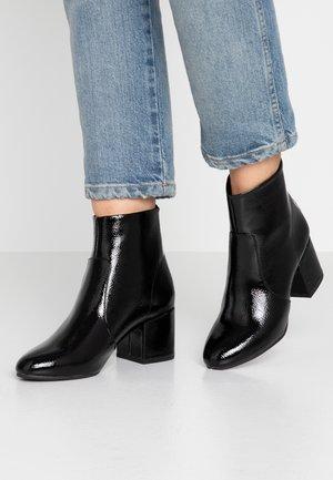CRINKLING - Ankle boots - black