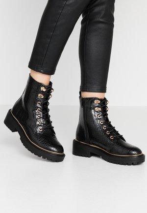 DAN - Platform ankle boots - black