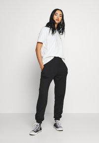 New Look - CUFFED JOGGER - Spodnie treningowe - black - 1
