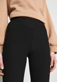 New Look - CROSS WAIST - Leggings - black - 4