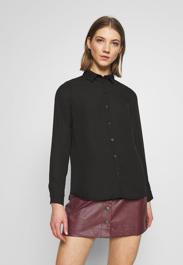 PLAIN SHIRT - Button-down blouse - black
