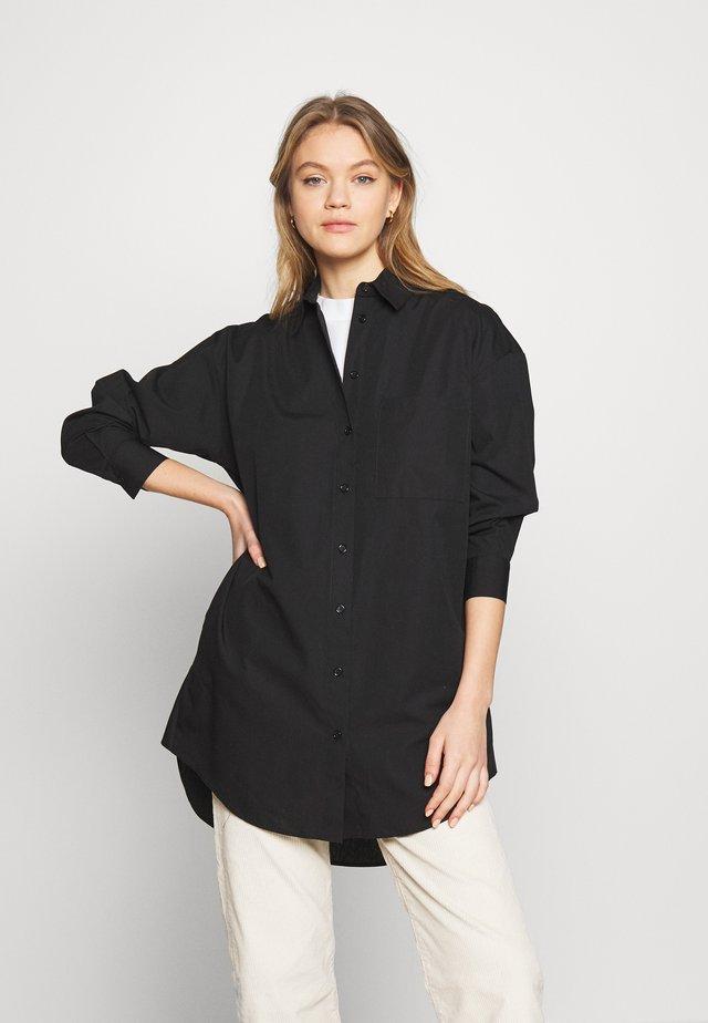 LENNY LONGLINE - Button-down blouse - black