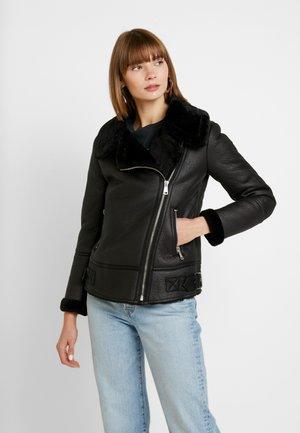 CHRISSY AVIATOR - Faux leather jacket - black
