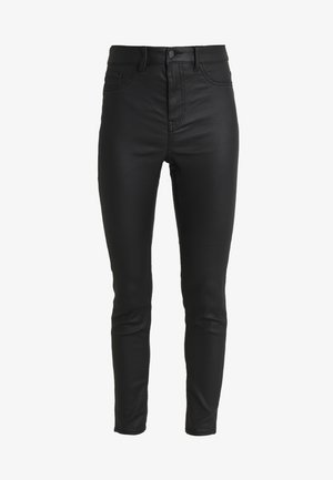 DISCO SUPERSKINNY COATED - Pantalones - black
