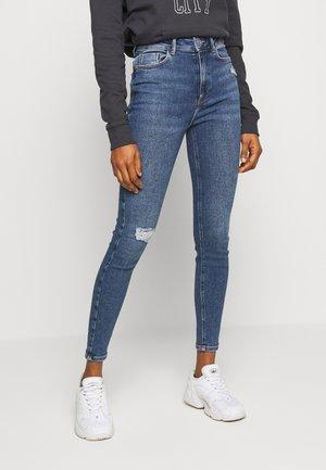 VINTAGE DISCO BUSTED KNEE KATHY - Jeans Skinny - teal