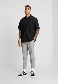 New Look - PHILIP GINGHAM PULL ON - Trousers - stone - 1