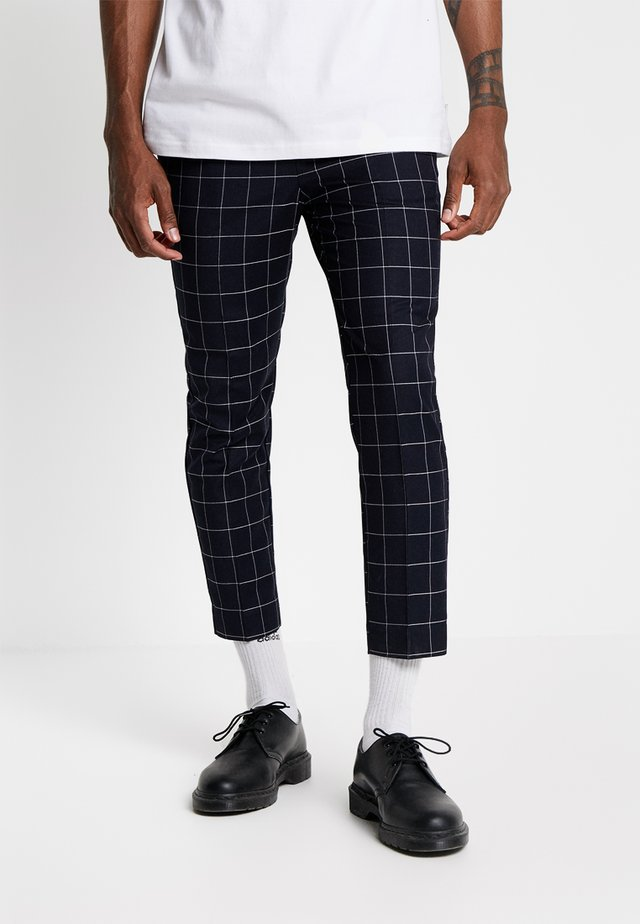 GRID CHECK CROP - Trousers - navy