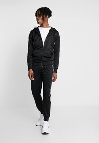 New Look - STREFLECTIVE SIDE JOGGER - Tracksuit bottoms - black - 1