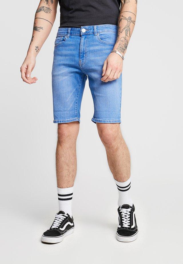 TRANS - Denim shorts - mid blue