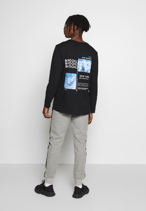 BACK PRINT CUFF - Long sleeved top - black