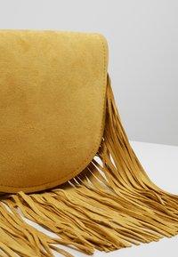 New Look - FRED FRINGE XBODY - Axelremsväska - bright yellow - 4