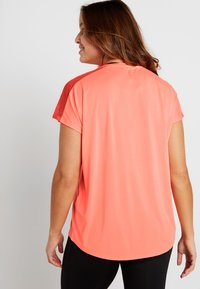 ONLY Play - ONPCALEXIA LOOSE TRAINING TEE - Funktionstrøjer - neon orange/paradise pink - 2