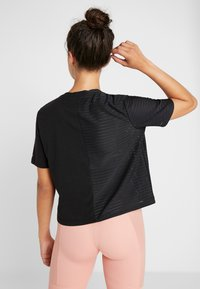 ONLY Play - ONPOLIANA SHORT TEE - T-shirts med print - black - 2