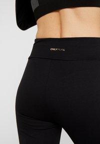 ONLY Play - ONPNEVE LEGGINGS  - Leggings - black/light bronze - 3