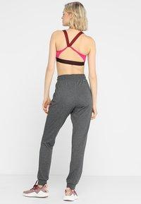 ONLY Play - ONPELINA PANTS - Spodnie treningowe - dark grey melange - 2