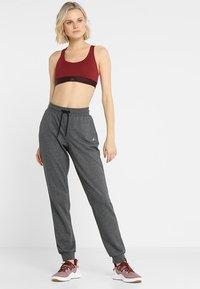 ONLY Play - ONPELINA PANTS - Spodnie treningowe - dark grey melange - 1