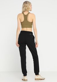 ONLY Play - ONPELINA PANTS - Jogginghose - black - 2