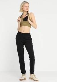 ONLY Play - ONPELINA PANTS - Jogginghose - black - 1