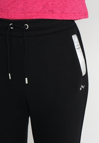 ONLY Play - ONPISABELLA LOOSE PANTS - Jogginghose - black - 4