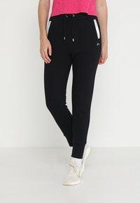 ONLY Play - ONPISABELLA LOOSE PANTS - Jogginghose - black - 0