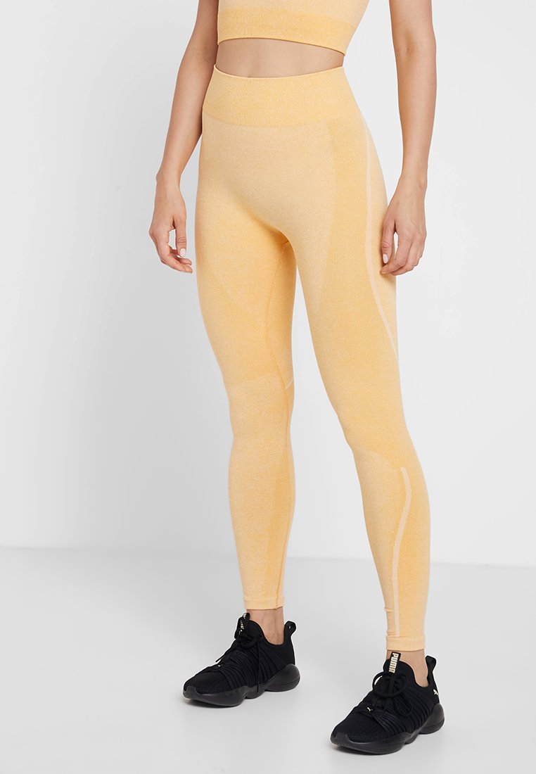 ONLY Play - ONPAMBER CIRCULAR  - Leggings - amber yellow/white melange