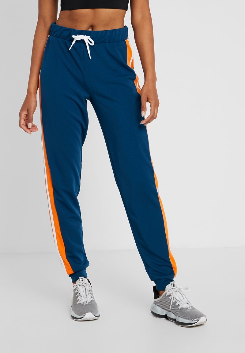ONLY Play - ONPTANGERINE LOOSE TRACK PANTS - Tracksuit bottoms - gibraltar sea/celosia orange