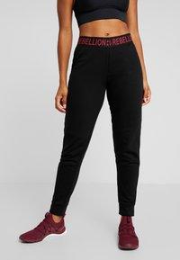 ONLY Play - ONPAERIES LOOSE BRUSH PANTS - Pantalones deportivos - black/beet red - 0