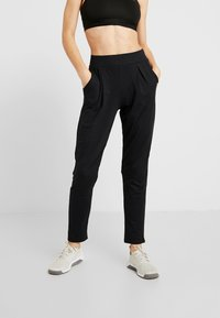 ONLY Play - ONPVENUS LOOSE PANTS - Tracksuit bottoms - black - 0