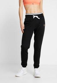 ONLY Play - ONPNAHLA PANTS - Pantalones deportivos - black - 0