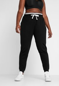 ONLY Play - ONPNAHLA PANTS CURVY - Verryttelyhousut - black - 0
